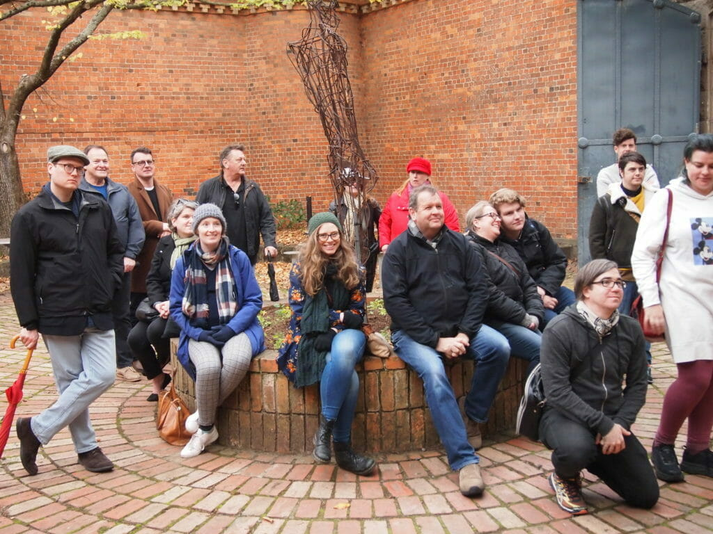 Ballarat Queer History Walking Tour attendees in the yard of the Old Ballarat Gaol